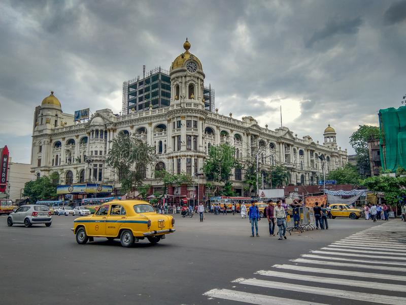 Cityscape, traffic of a notable city road near Esplanade with a yellow taxi at stock image