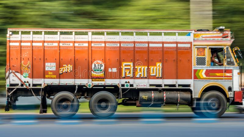 A Cargo transport truck also known as lorry speeding through the city of Kolkata royalty free stock image