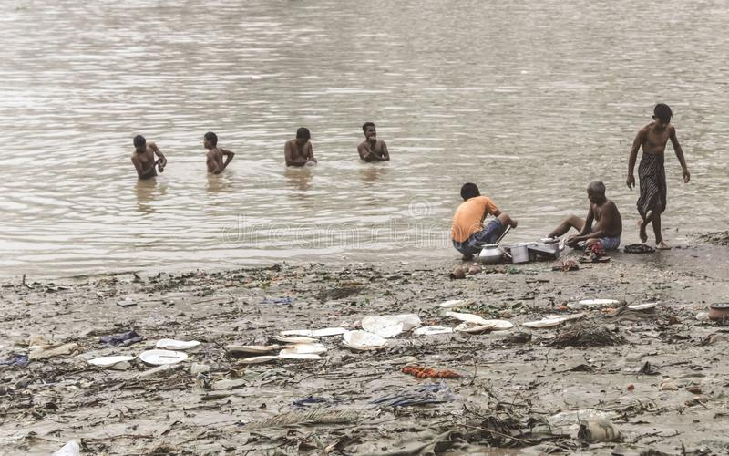 Kolkata, West Bengal, India 15 October, 2018 - People taking a bath on polluted bank of Ganges Ghat Hooghly River. Despite. National Green Tribunal indicates royalty free stock photography
