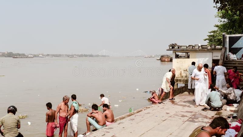 Kolkata, West Bengal, India 15 October, 2018 - View of The heritage Prinsep Ghats along bank of the Hooghly River. People gathered royalty free stock image