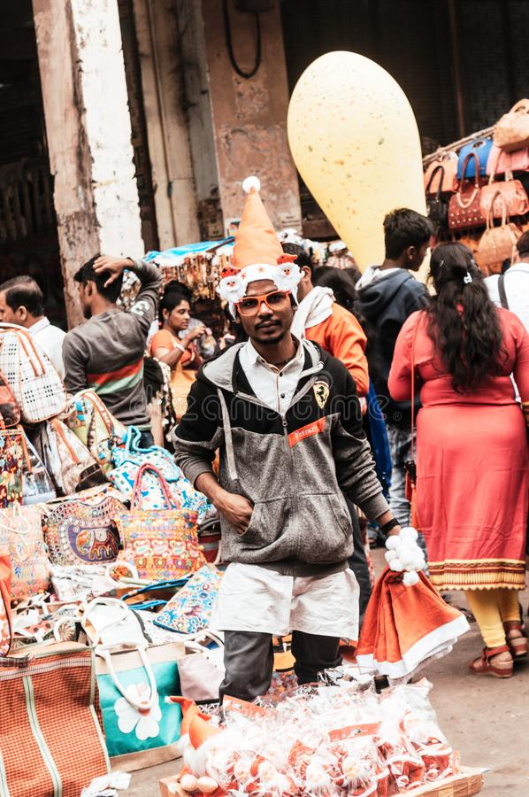 Kolkata, West Bengal, India 25th December, 2018 - A street hawker selling Christmas cap in the street of kolkata while nicely royalty free stock images
