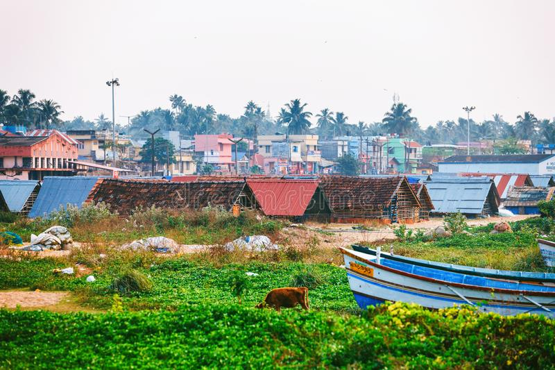 Typic street of Kollam pier marine close to Fishing boats on the beach of Kollam, India. Kollam, India - 14 February 2016: Typic street of Kollam pier marine stock photography