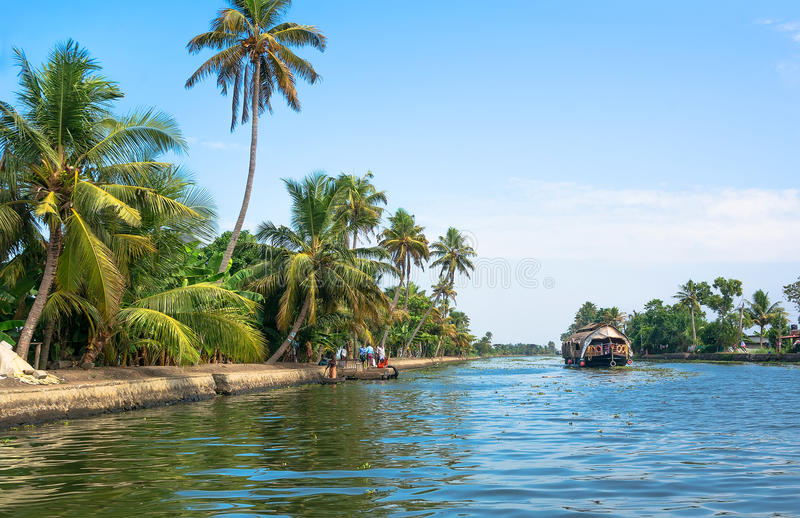 Kollam, India 2017: Fishing boat on the river near Kollam on Kerala backwaters, India. Kollam, India - 2017: Fishing boat on the river near Kollam on Kerala stock image