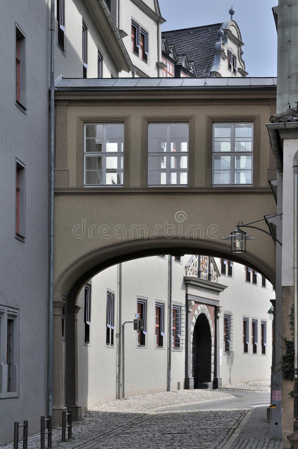 Kollegiengasse foreshortening, wiemar. Bridge and facade of ancient baroque palace in city center, shot in sunny weather stock photo