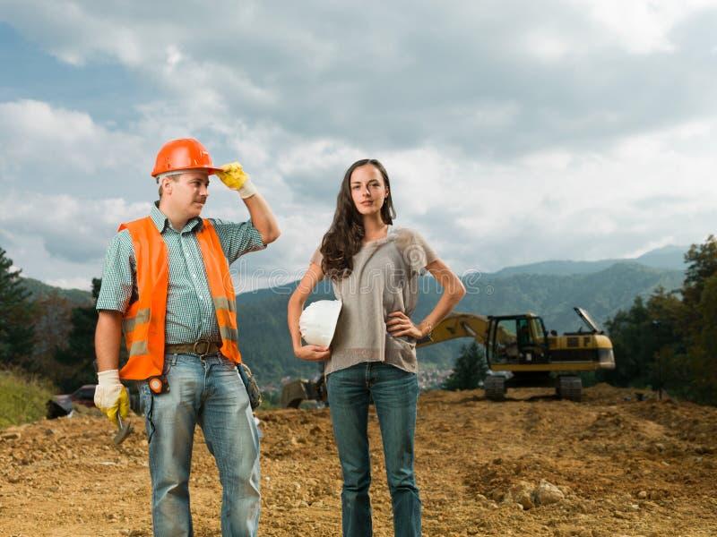 Kollegor på konstruktionsplats arkivbild