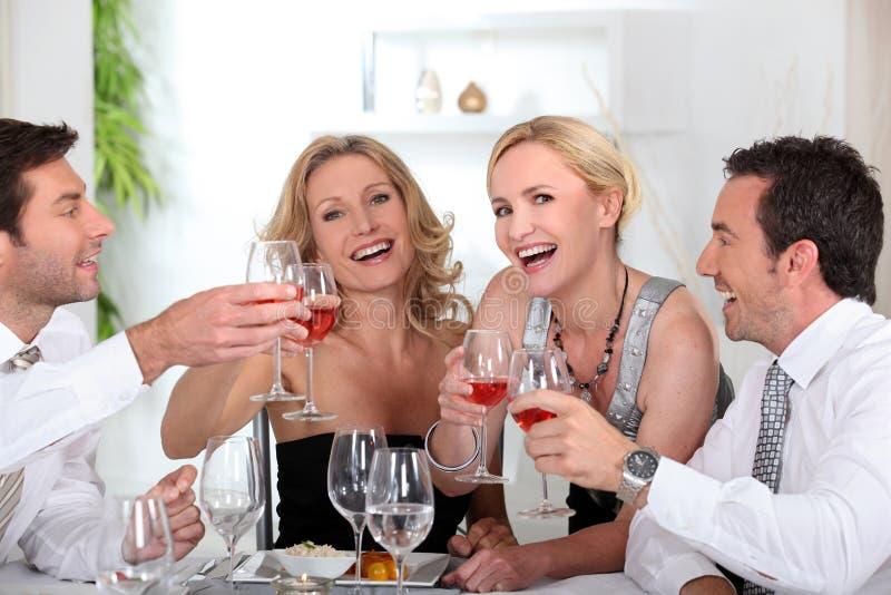 kollegor som dricker glass wine royaltyfri bild