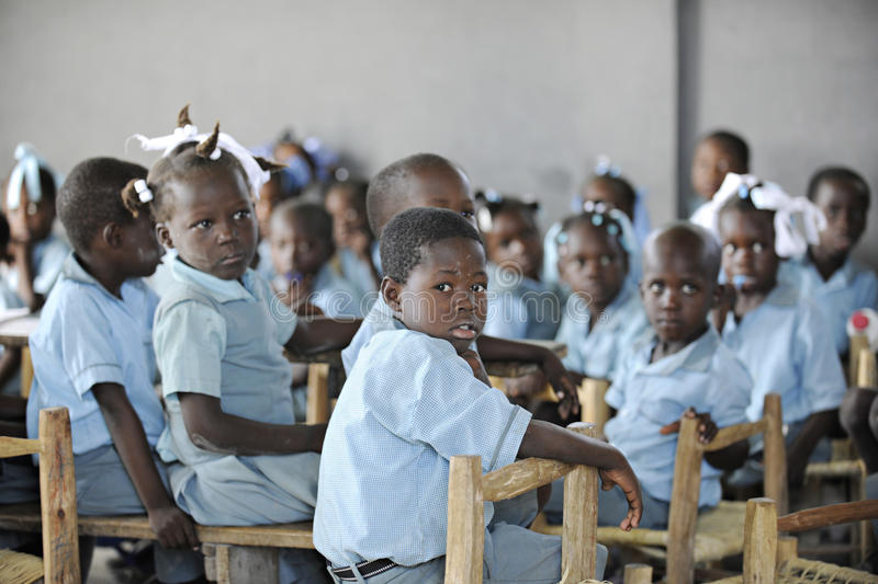 KOLMINY, HAITI - FEBRUARY 12, 2014: A class of elementary school children royalty free stock photography