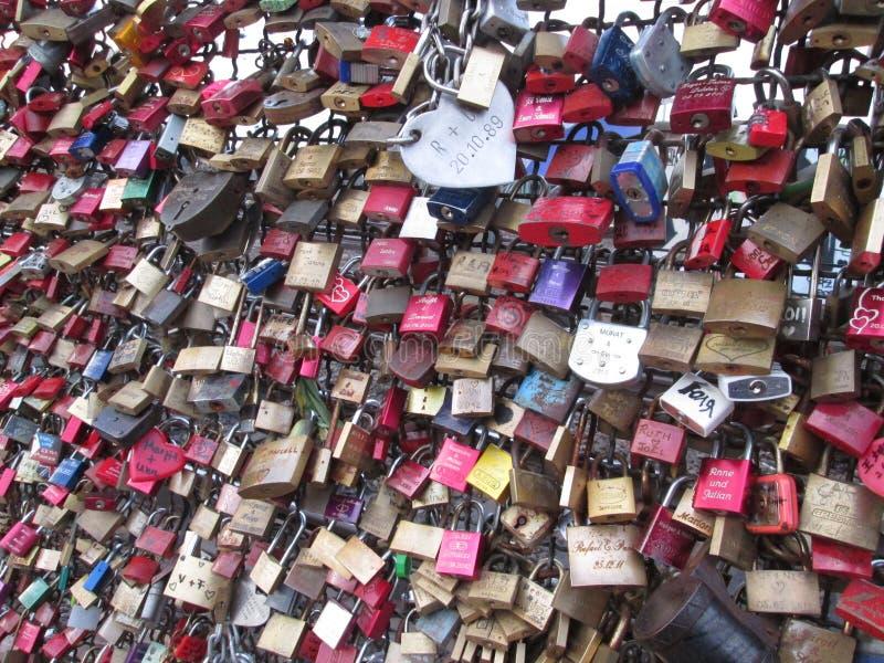 Koln with locks on the train bridge royalty free stock photos
