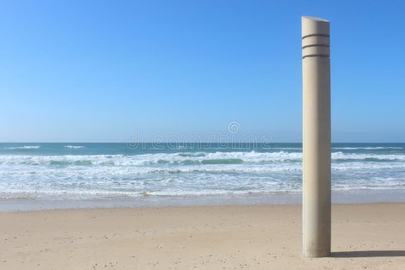 Kolonn på stranden royaltyfria bilder
