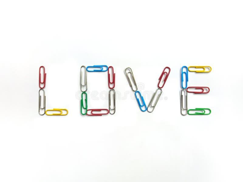 Kolorów paperclips kochać na białym tle zdjęcia royalty free
