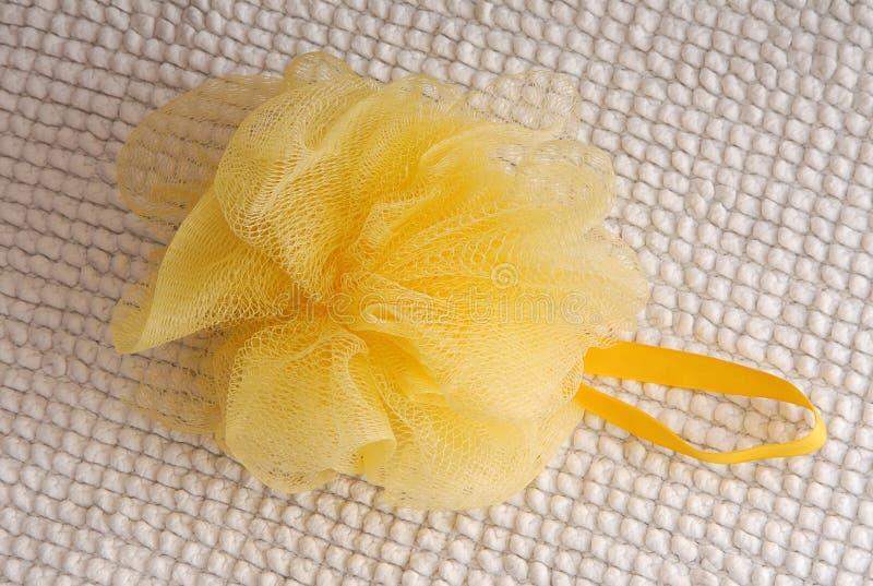 Kolor żółty kąpielowa gąbka fotografia stock