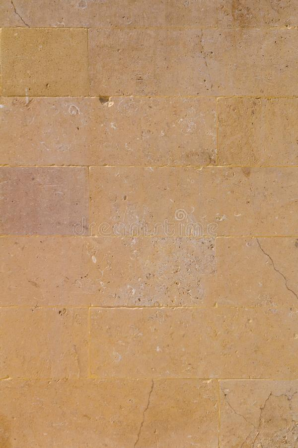 Kolor żółty starzejący się piaskowcowy ściana z cegieł tło zdjęcie stock