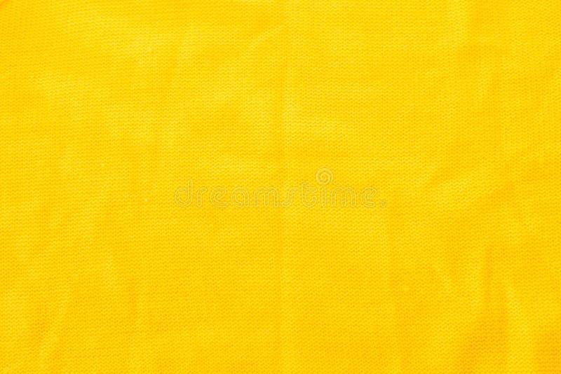 Kolor żółty szydełkująca tkaniny tekstura Materiał crumped troszkę obrazy stock