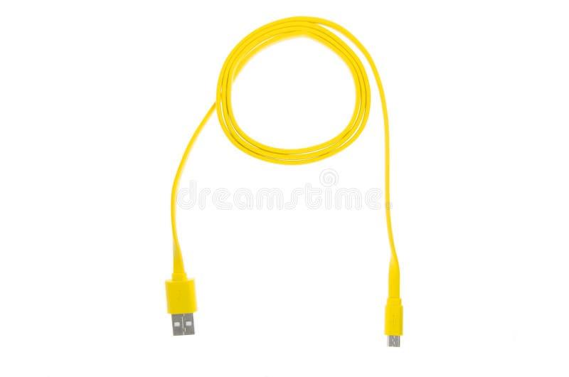 Kolor żółty zanudzał USB kabel na białym odosobnionym tle zdjęcie royalty free
