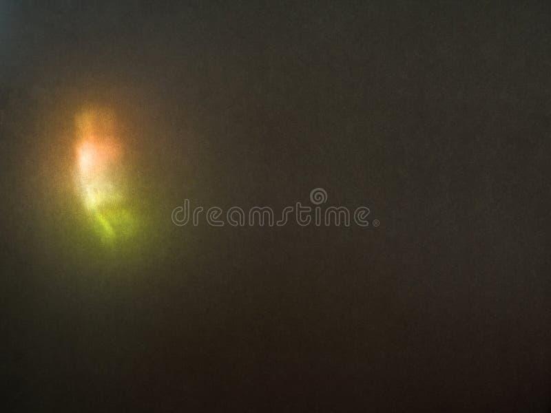 Kolor zamazujący defocused hałaśliwie jaskrawy odbijający światło Świecenie widmo, światło słoneczne punkt na ciemnym tle fotografia stock