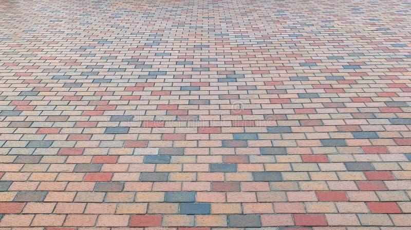 Kolorowa cegła kamienia ulicy droga Chodniczek, bruk tekstury tło obraz royalty free