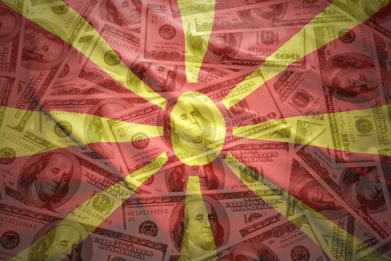 Kolorowa falowania macedonian flaga na dolarowym pieniądze tle obraz royalty free