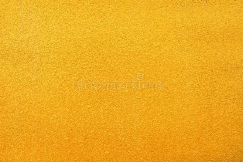 Kolorowa jaskrawa złocista farby betonowa ściana deseniuje tekstura abstrakt dla tła zdjęcia royalty free