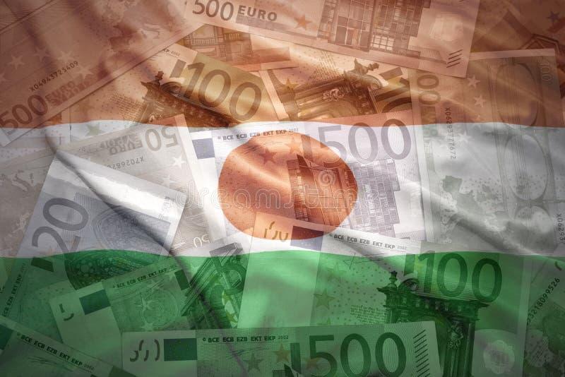 Kolorowa macha Niger flaga na euro tle obraz royalty free