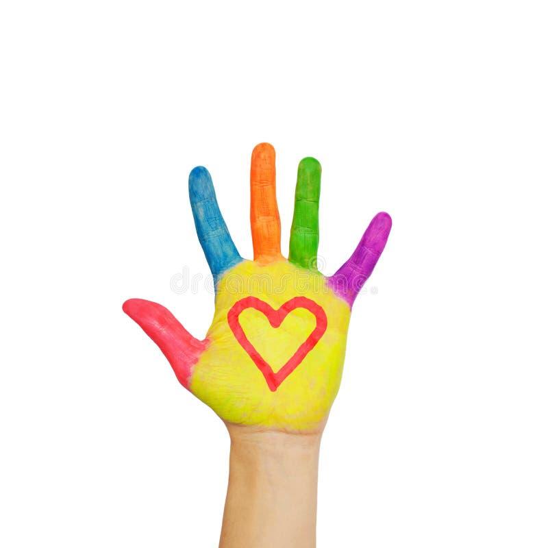 Kolorowa malująca ręka z kierowym symbolem rysującym na palmach. zdjęcie royalty free