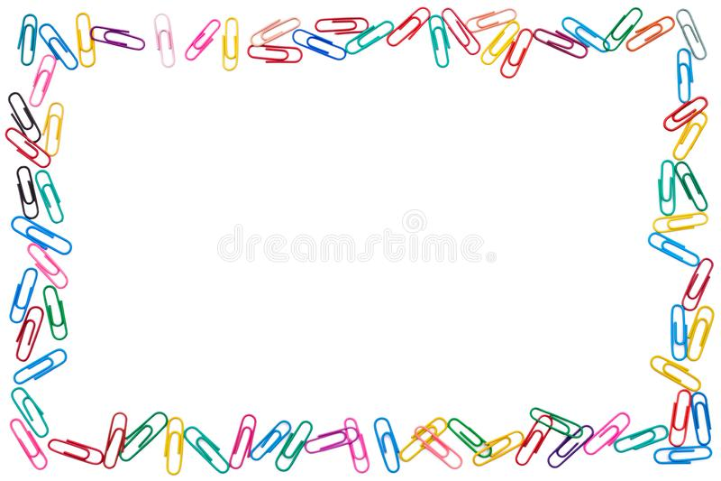 Kolorowa rama cluttered papierowe klamerki na białym tle zdjęcia royalty free