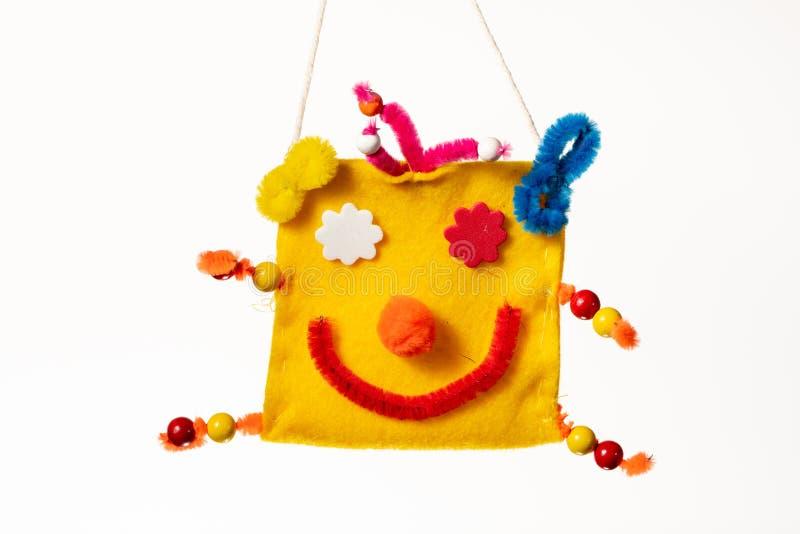 Kolorowa torba z twarzą błazen robić dzieckiem zdjęcie royalty free