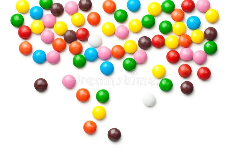 Kolorowe Czekoladowego cukierku pigułki Odizolowywać na Białym tle zdjęcia stock