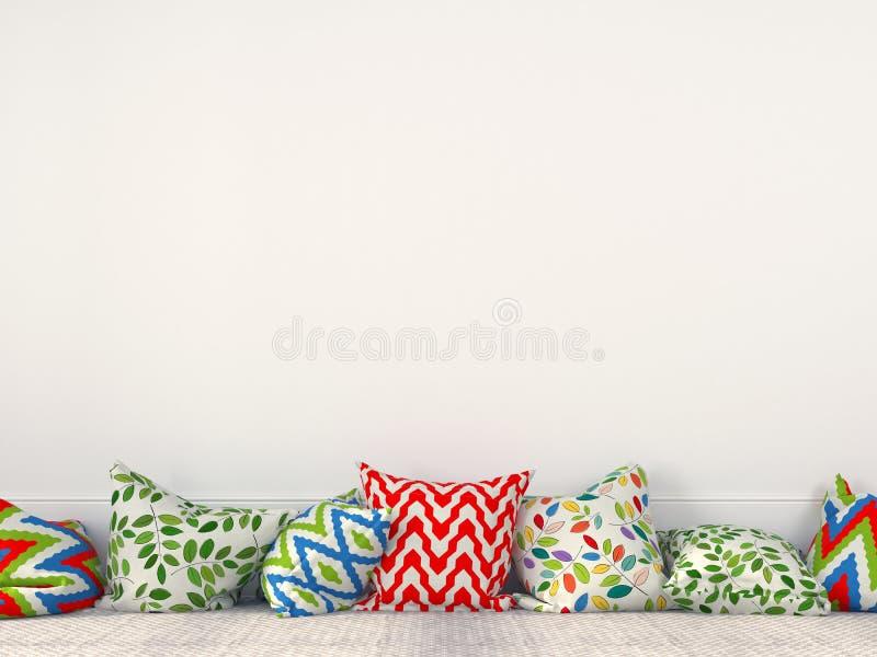 Kolorowe poduszki blisko białej ściany fotografia royalty free