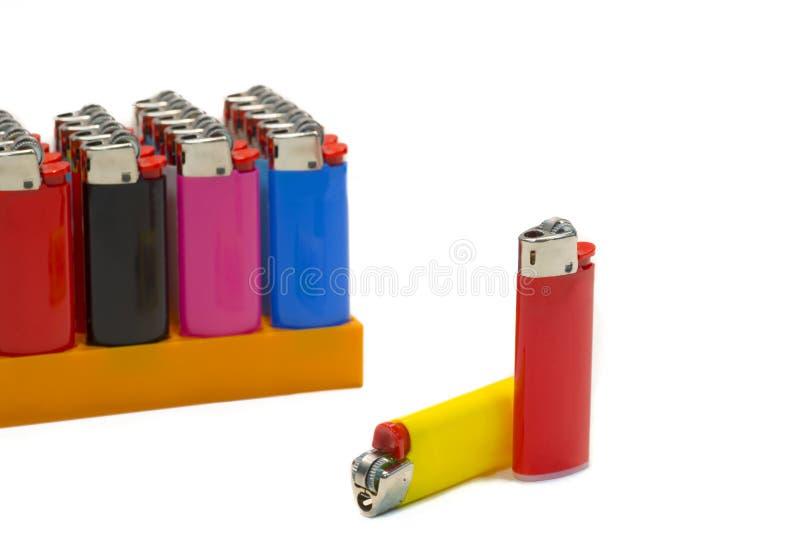 Kolorowe zapalniczki na białym tle zdjęcie stock