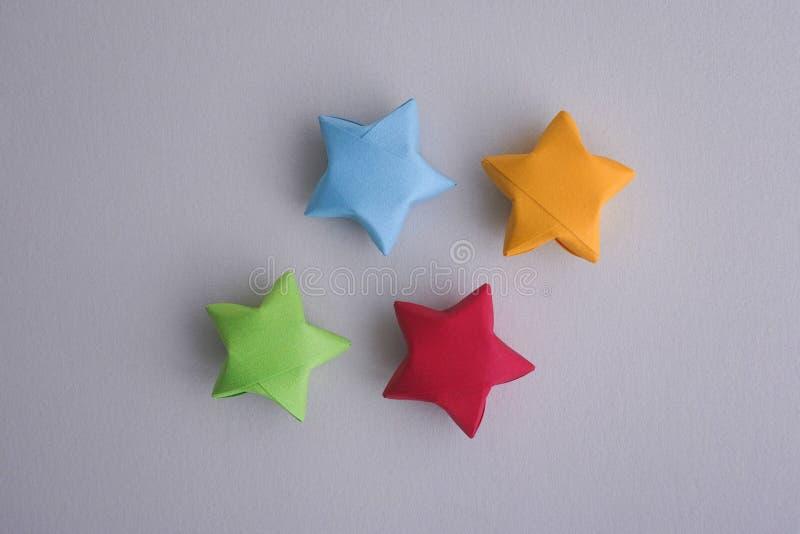 Kolorowego origami szczęsliwe gwiazdy zdjęcie stock
