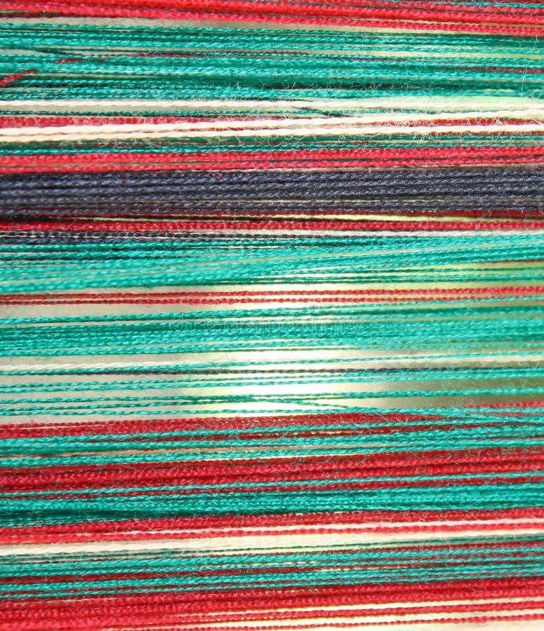 Kolorowi boże narodzenia wyplatający frabics tło fotografia stock