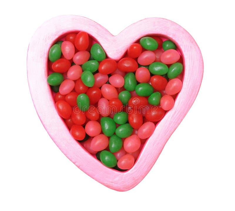 Kolorowi cukierki na kierowych kształtach fotografia stock