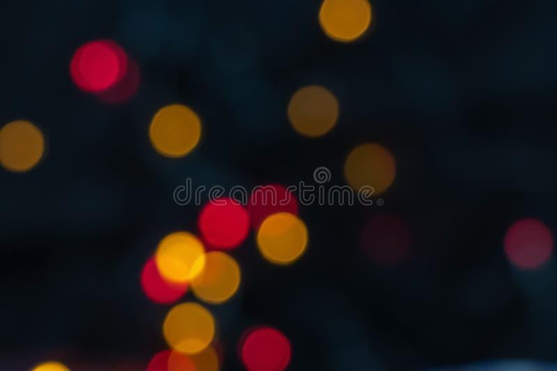 Kolorowi czerwieni i koloru żółtego bokeh światła abstrakcjonistyczni Świąt tło obrazy royalty free