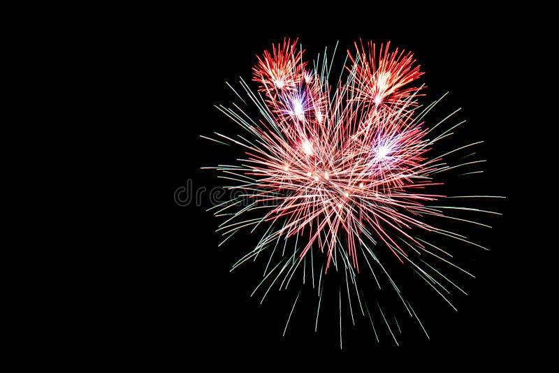 Kolorowi fajerwerki przeciw czarnemu niebu zdjęcia royalty free