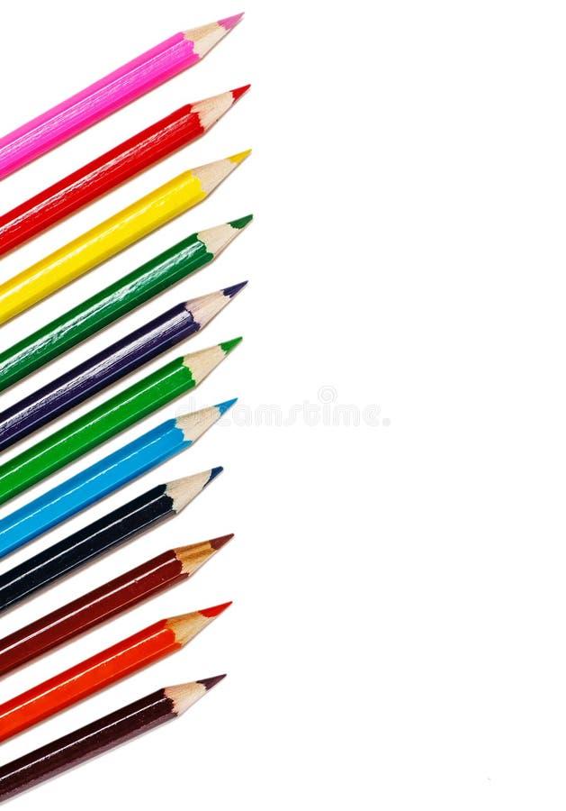 Kolorowi ołówki odizolowywający na bielu zdjęcia royalty free