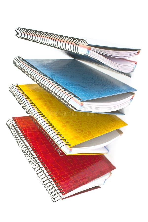 Kolorowi otwarci ślimakowaci notatniki fotografia stock