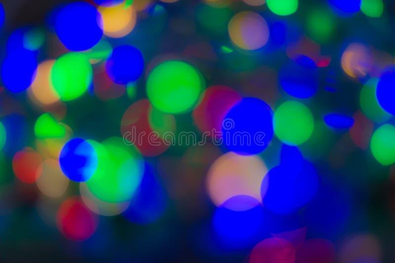 Kolorowy bokeh światła połysk, iskrzasty luksusowy uroczysty jaskrawy dla tło kosmetyków reklamować fotografia stock