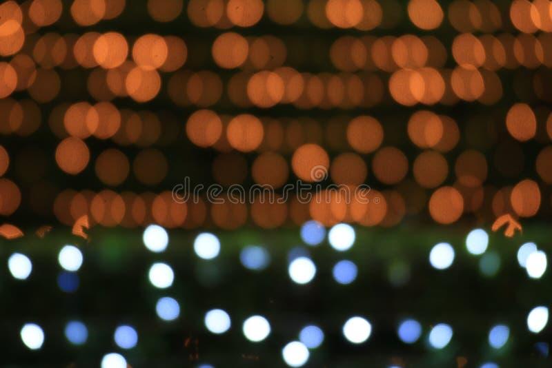 Kolorowy bokeh złota światła nocy tła dwa brzmienie ścienny, złoto i natura tło, zamazywał bokeh jaskrawego, Buddha światła forma obrazy royalty free