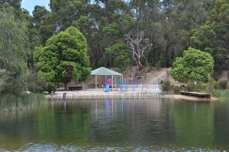 Kolorowy children boisko obok jeziora w kraju zdjęcia stock