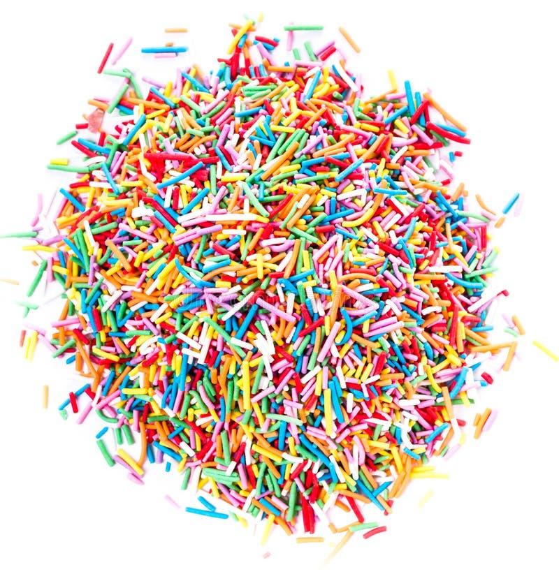 Kolorowy Cukrowy cukierek kropi odosobnionego na białym tle obrazy stock