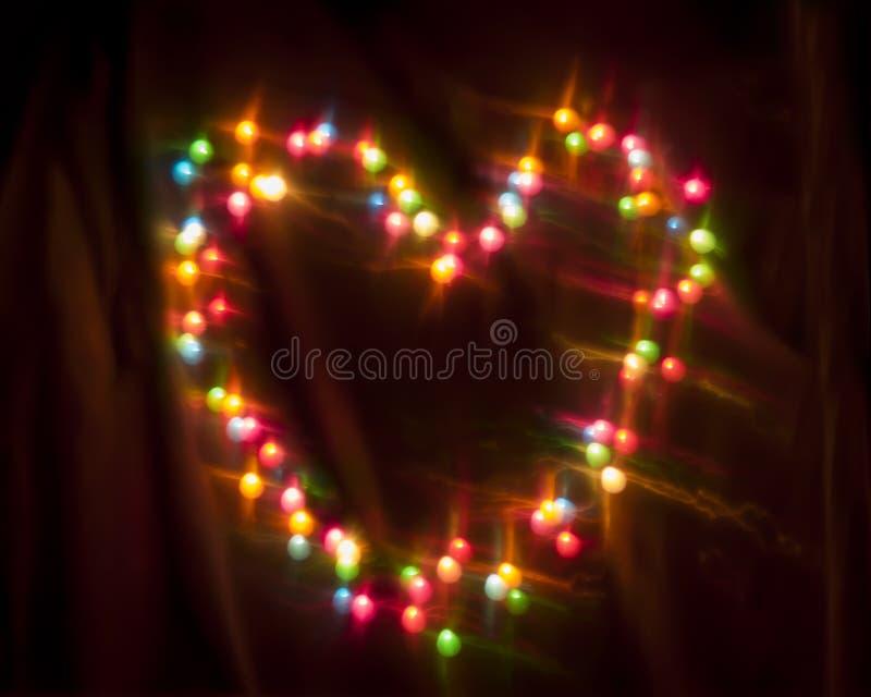 Kolorowy jarzyć się okrąża Bokeh na ciemnym tle obrazy stock