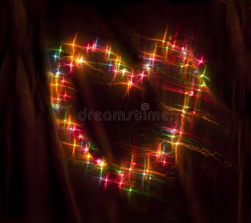 Kolorowy jarzyć się okrąża Bokeh na ciemnym tle zdjęcie royalty free