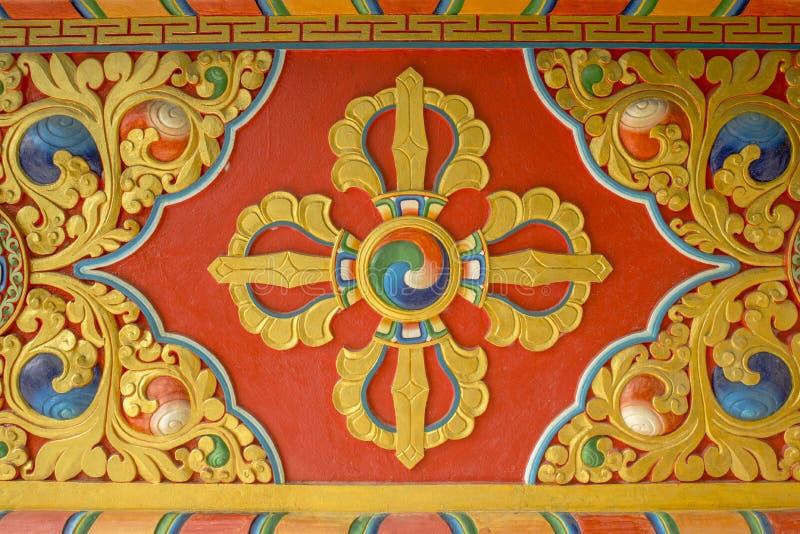 Kolorowy jaskrawy czerwony żółty błękitny Buddyjski vajra wizerunek na ścianie świątynia wizerunki święci fotografia stock