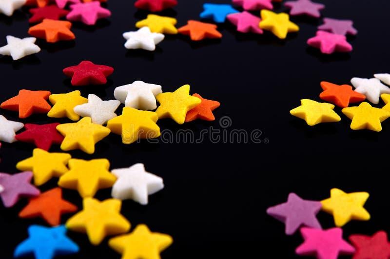 Kolorowy jaskrawy tło, barwić gwiazdy S?odki ?adny t?o cukierek zdjęcia royalty free