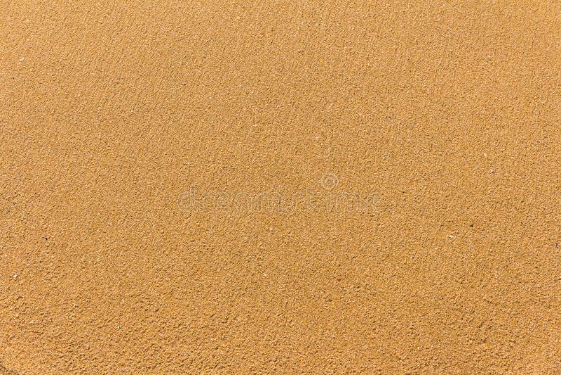 Koloru żółtego piaska świetna tekstura fotografia royalty free