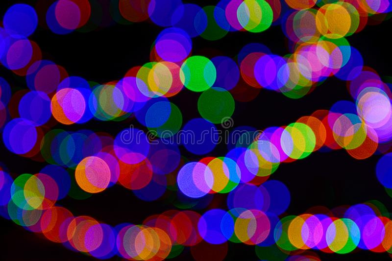 Koloru bokeh zamazani okręgi na czarnym tle fotografia stock