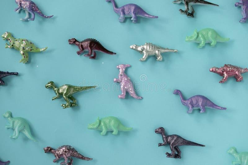 Koloru dinosaura figurki Plastikowy udział na cyraneczki powierzchni fotografia royalty free
