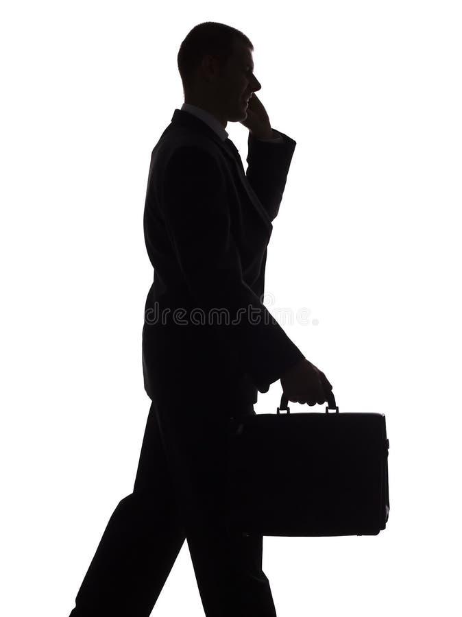 komórka człowieka sylwetki walizki, obraz stock