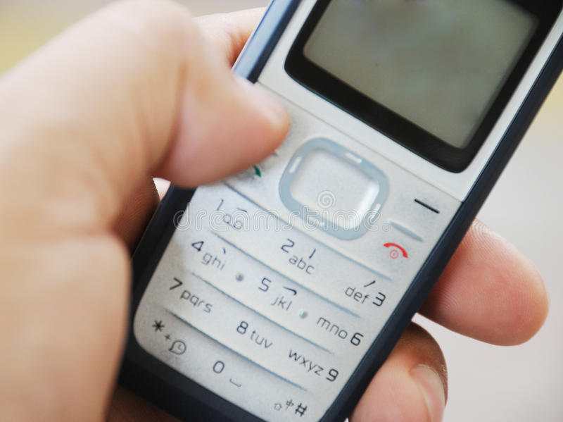komórki ręki mienia pda telefon obraz royalty free