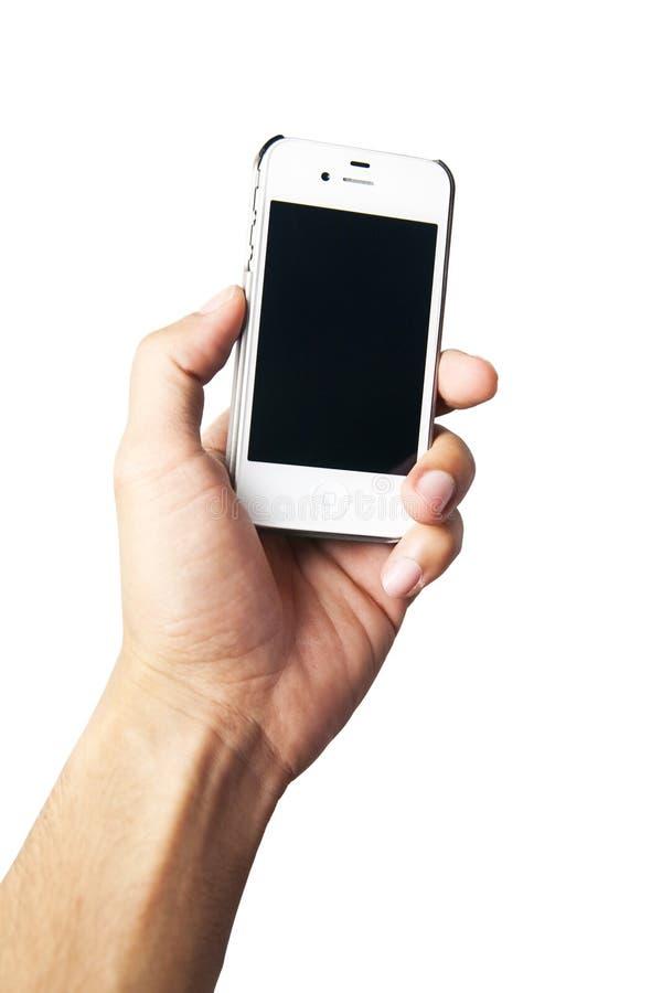 komórki ręki mienia telefonu biel obraz royalty free